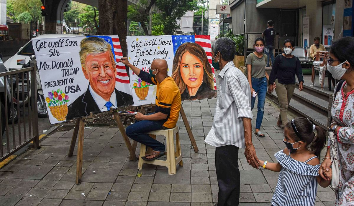 Gurukul teacher makes a painting of US President Donald Trump and US First Lady Melania Trump after they tested positive for COVID-19, at Lalbaug in Mumbai, Friday, 2 October.