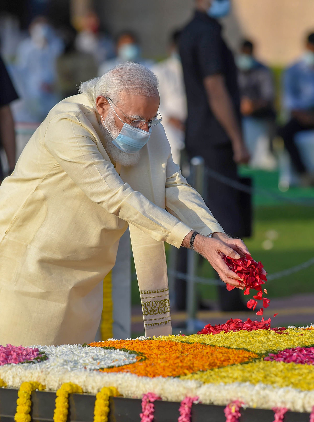 Prime Minister Narendra Modi pays tribute to Mahatma Gandhi on the occasion of his 151st birth anniversary, at Rajghat in New Delhi, Friday, 2 October.