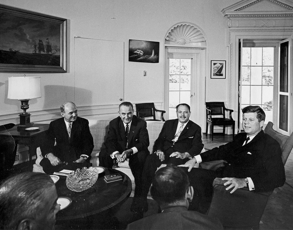 President John F. Kennedy Meets with Mohammad Ayub Khan, President of Pakistan; 11 July 1961. (L – R): Secretary of State Dean Rusk; Vice President Lyndon B. Johnson; President Mohammad Ayub Khan; President Kennedy (seated in fabric-covered rocking chair).