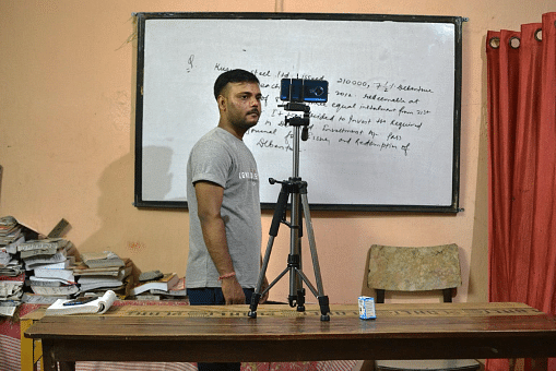 Ajay borrowed a tripod stand to start with online classes.