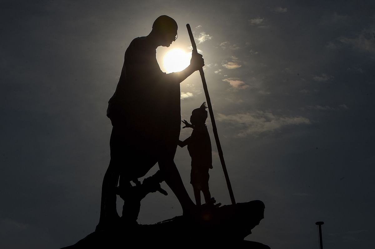 A worker cleans Mahatama Gandhi statue on the eve of his birth anniversary at Marinabeach, in Chennai. On Thursday, 1 October.