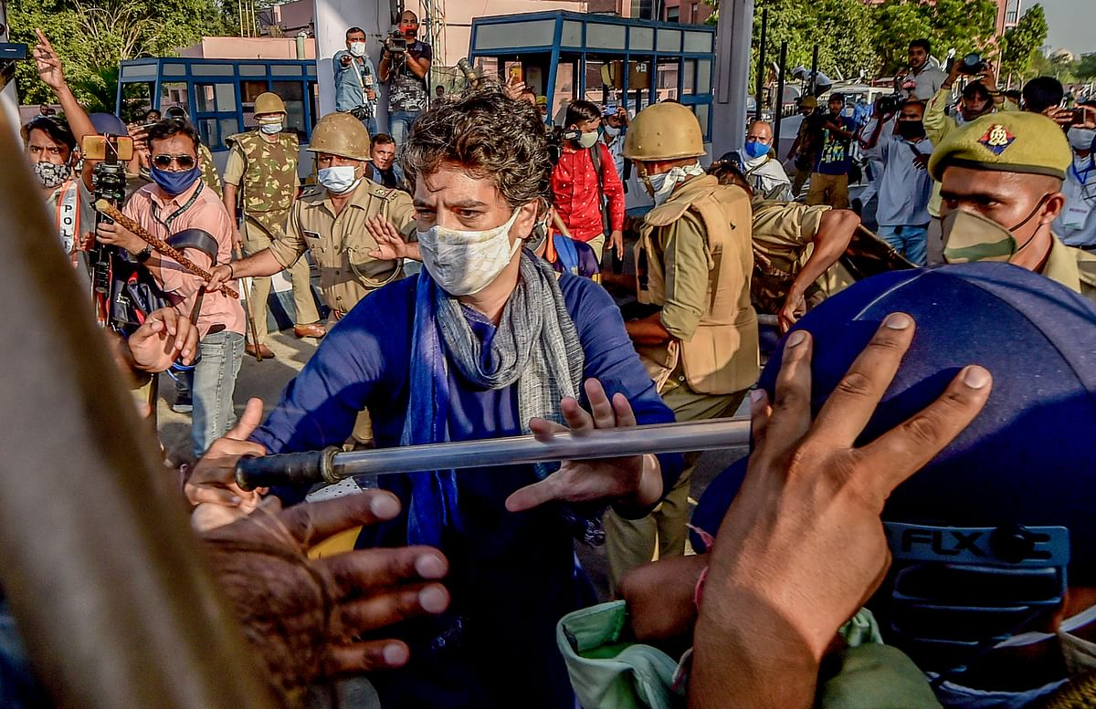 Congress leader Priyanka Gandhi sheilds party workers being lathi charged.
