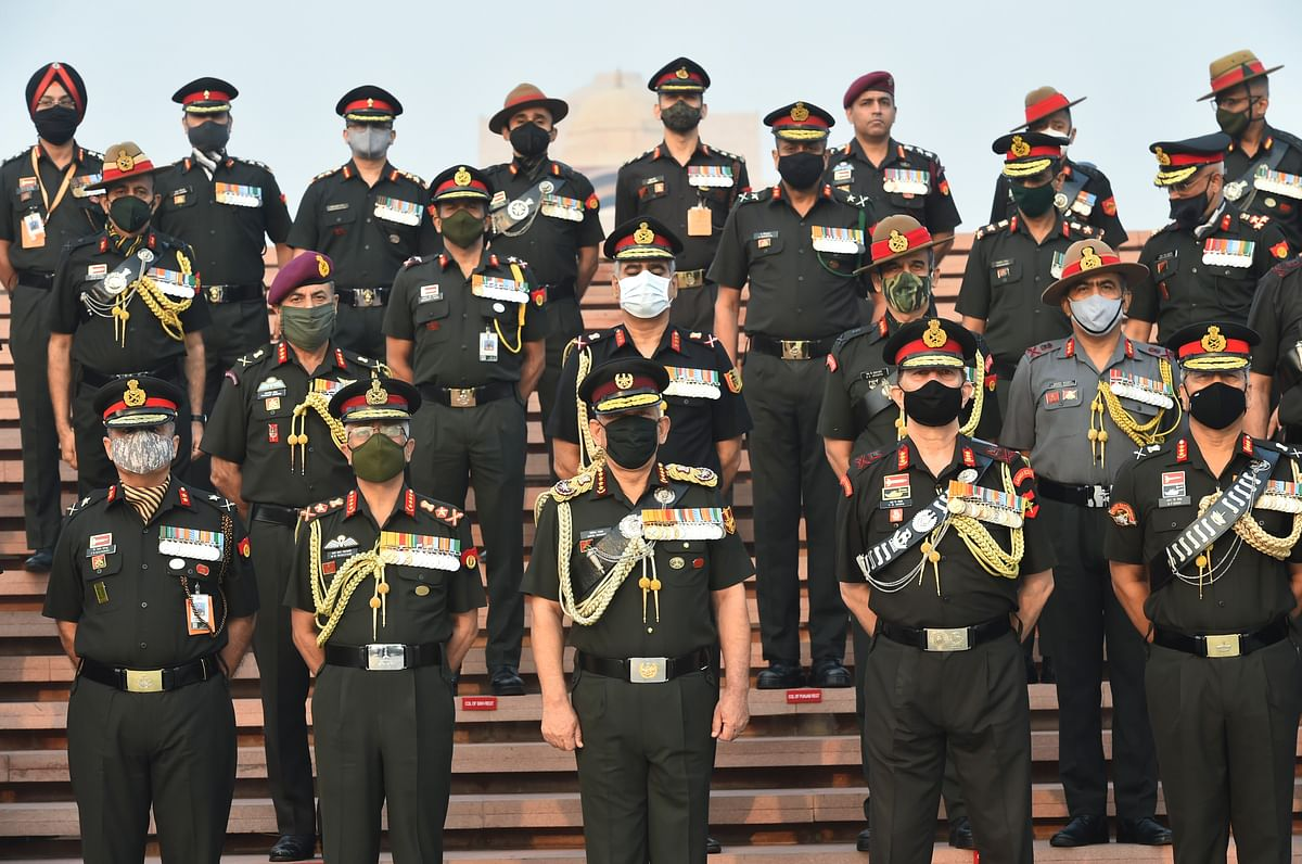 Chief of Defence Staff, General Bipin Rawat and Chief of Army Staff, General MM Naranave pose for a group photograph with other officers at National War Memorial on Infantry Day, in New Delhi