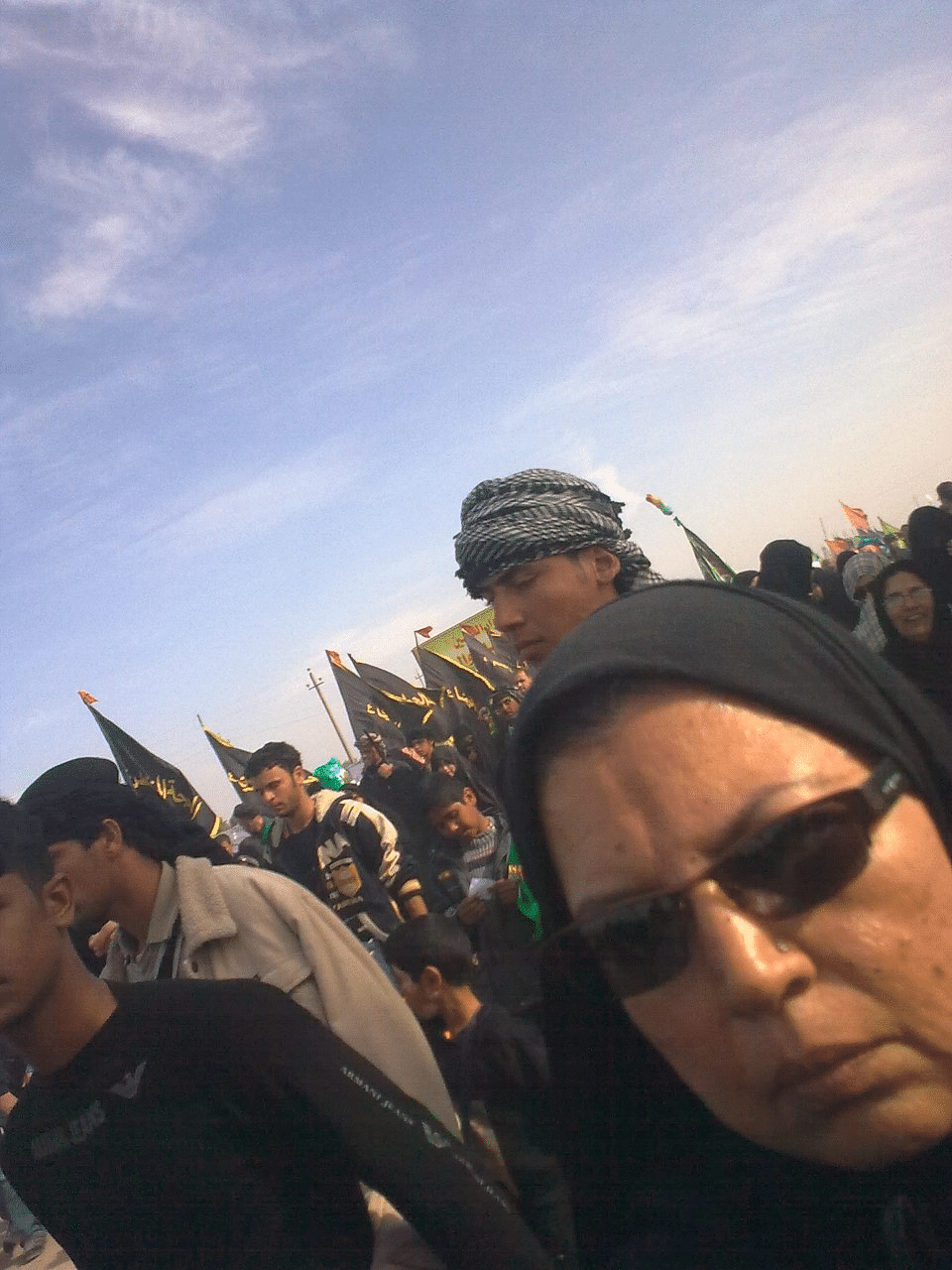 Walking with the ziareens (pilgrims) to Karbala.