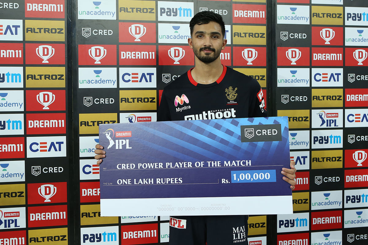 Devdutt Padikkal of Royal Challengers Bangalore receives the CRED Power Player of the match award during match 3 of season 13 of the Dream 11 Indian Premier League.