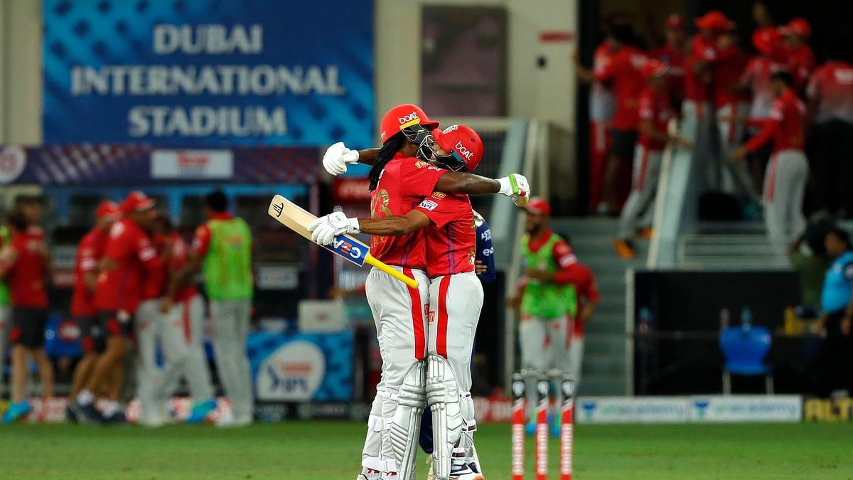 Chris Gayle and Mayank Agarwal of Kings XI Punjab celebrate their win against Mumbai Indians.