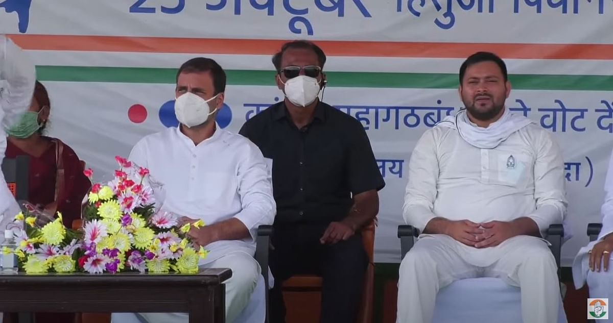 Tejashwi Yadav could be seen without a mask next to Gandhi.