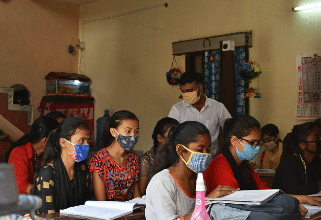 Ajay monitoring students individually and attending to their doubts.