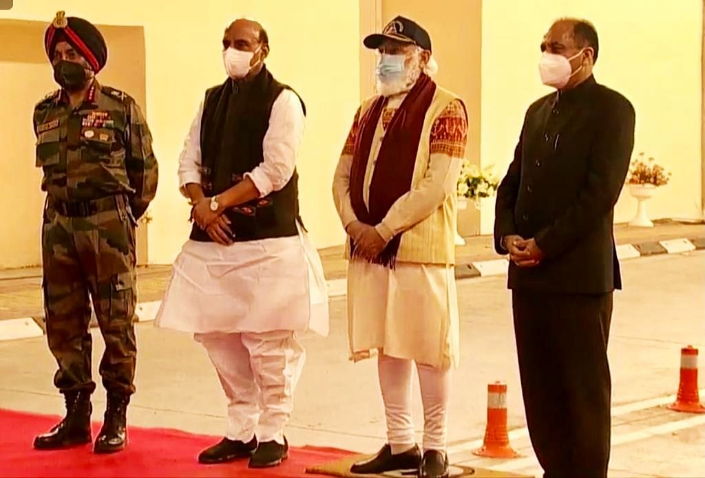 Prime Minister Narendra Modi (C) with Defence Minister Rajnath Singh, Himachal Pradesh CM Jai Ram Thakur (R) and Director General of BRO Harpal Singh (L) during the inauguration of Atal tunnel, in Manali.