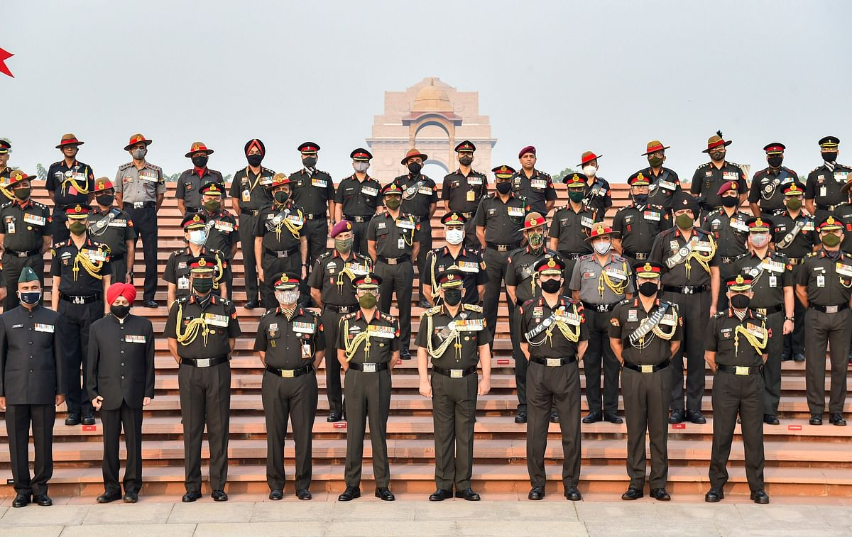 Chief of Defence Staff, General Bipin Rawat and Chief of Army Staff, General MM Naranave pose for a group photograph with other officers at National War Memorial on Infantry Day, in New Delhi, Tuesday, 27 October, 2020.