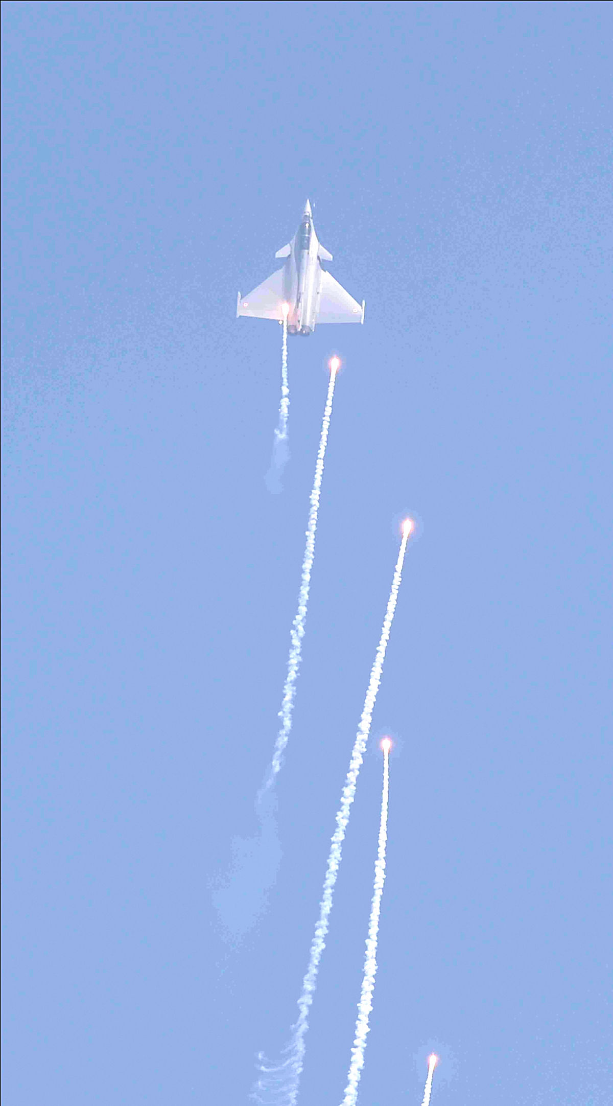 Rafale fighter aircraft of the Indian Air Force fires flares during the 88th Indian Air Force Day celebrations, at Hindon Airbase in Ghaziabad.