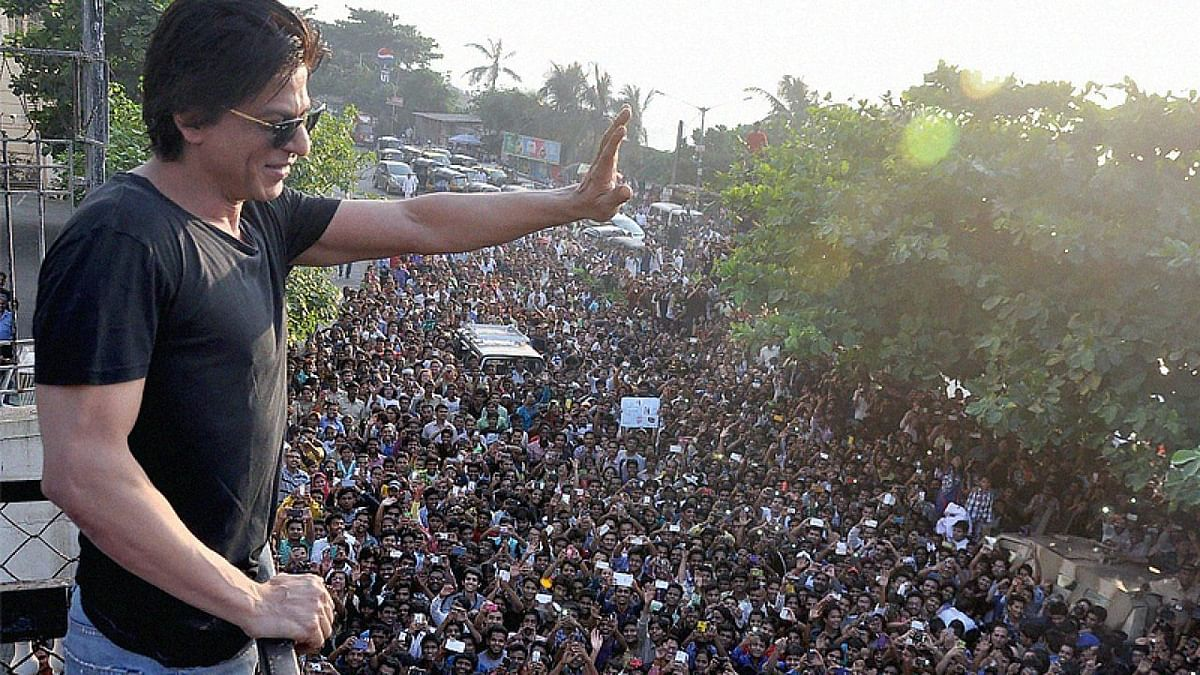 File photo of Shah Rukh Khan waving at a crowd gathered outside his home in Bandra.