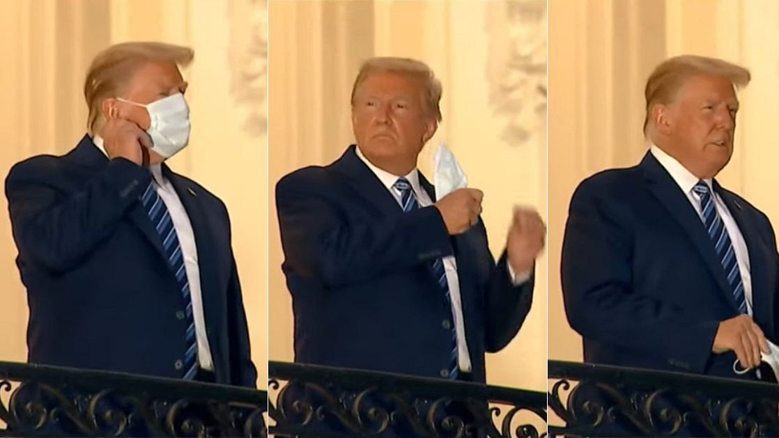 US President Donald Trump removes his mask after returning to White House.