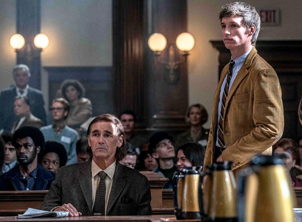 Eddie Redmayne as Tom Hayden