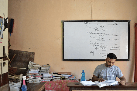 Ajay Kumar, 28, manages time between his coaching classes to prepare for the civil services exam.