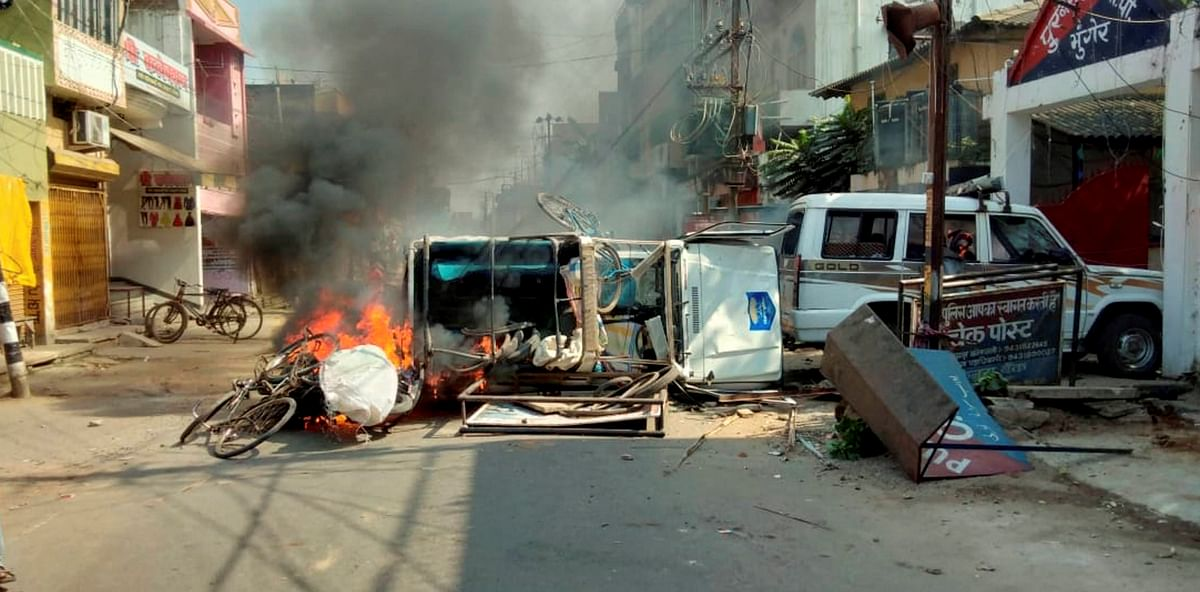 A vehicle in flames after it was set on fire by an angry mob during a protest over recent police firing during a Durga Puja event, in Munger, Thursday, 29 October