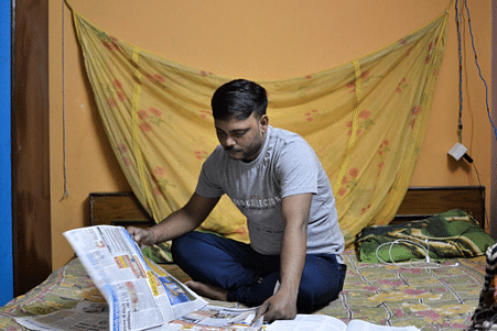 Ajay catches up on current affairs for his IAS preparation.