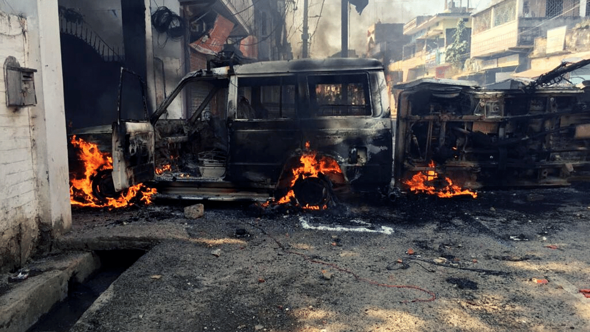 Mob set a police vehicle on fire in Munger