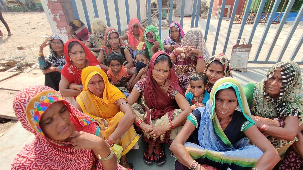 Women waiting at Noida's labour chowk with their kids. Image used for representation.