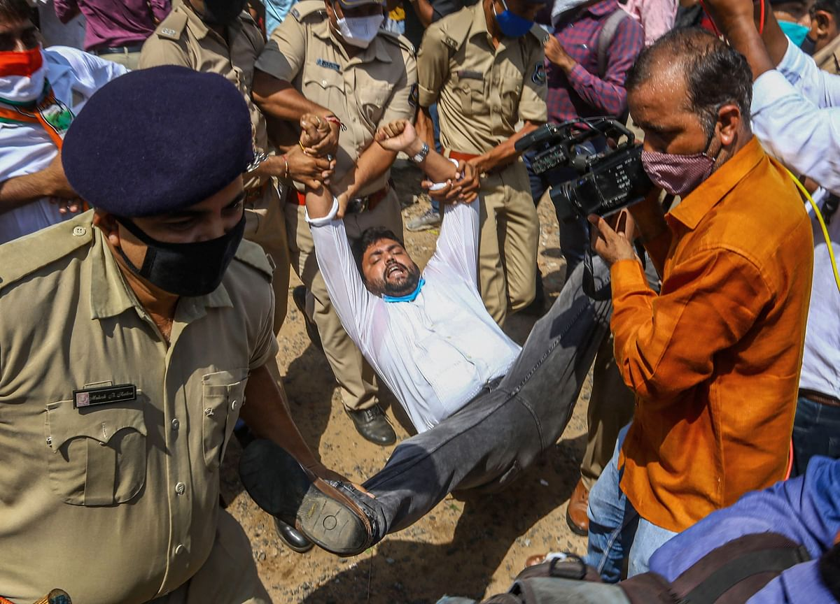 Police detain supporters of the Congress Party during their protest against farm law, outside the collector office in Ahmedabad, Friday, 2 October.