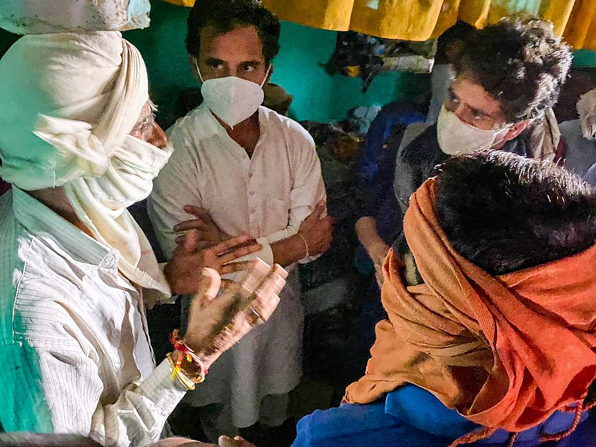 Congress leaders Priyanka Gandhi Vadra and Rahul Gandhi meet the family members of a 19-year-old Dalit woman who died after being allegedly raped two weeks ago, at Bulgadi village in Hathras, Saturday, 3 October.