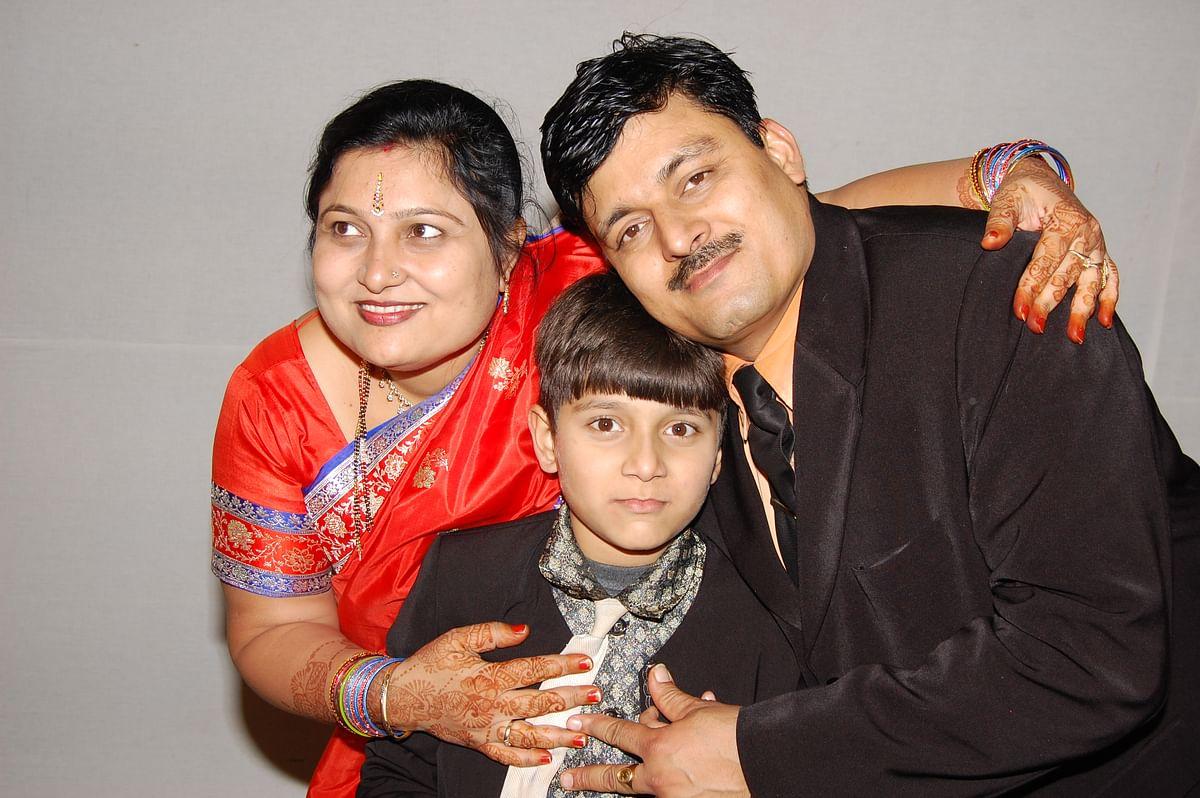 Late Sanjay Sharma with his wife Aruna and son Hrithik.