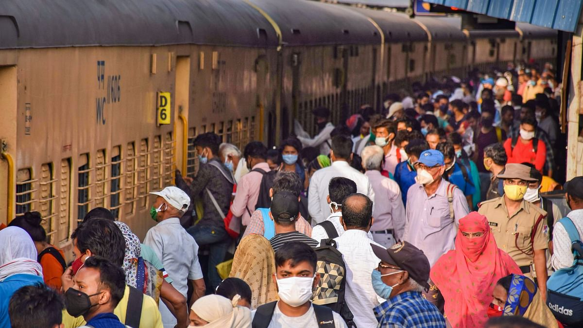 Passengers board a train in Lucknow.