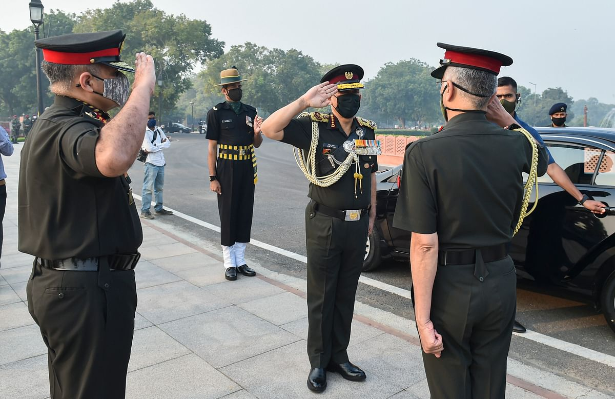 Chief of Defence Staff, General Bipin Rawat salutes Chief of Army Staff, General MM Naravane as he leaves after paying tribute at National War Memorial on Infantry Day
