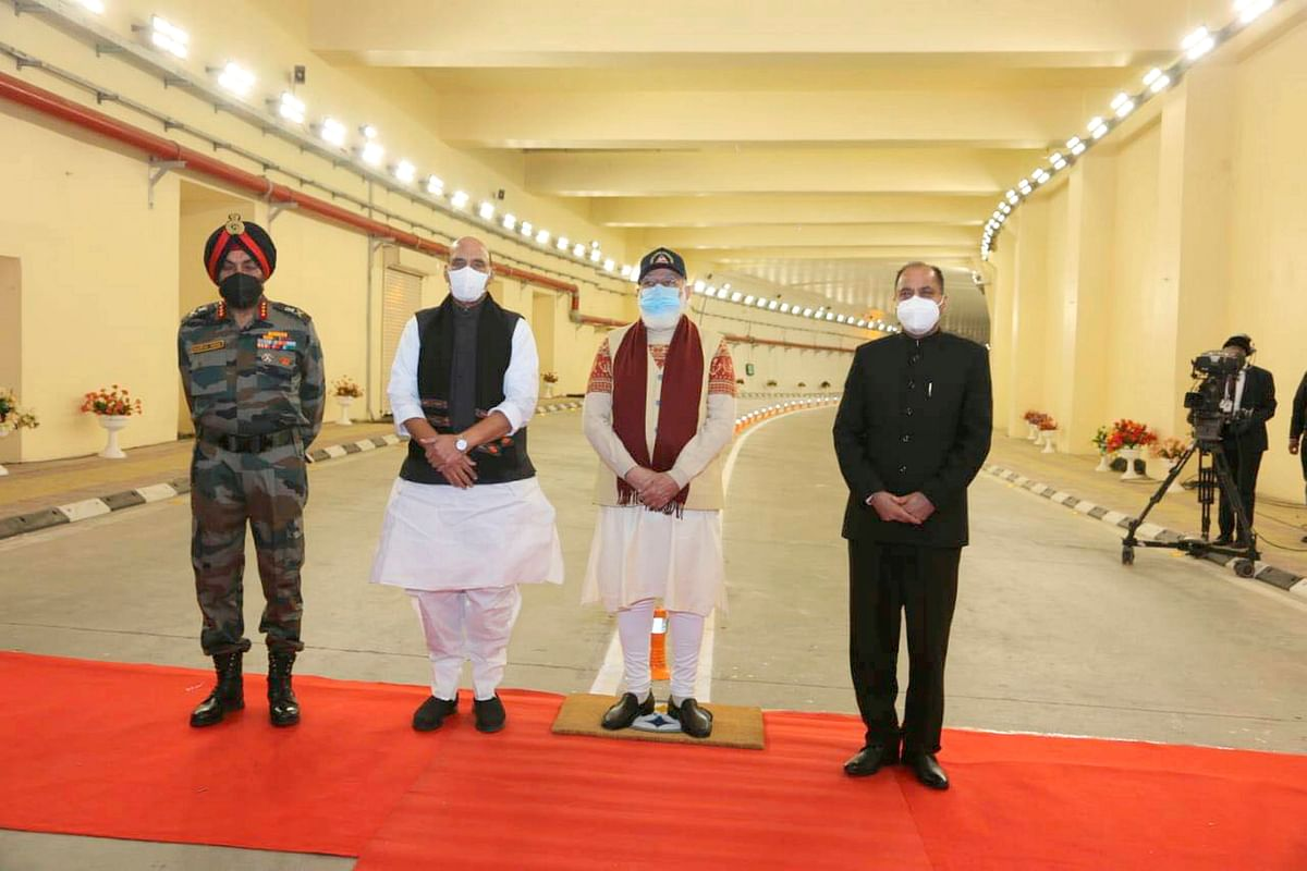Prime Minister Narendra Modi with Defence Minister Rajnath Singh, Himachal Pradesh CM Jai Ram Thakur (R) and Director General of BRO Harpal Singh (L) during the inauguration of Atal Tunnel, in Manali.