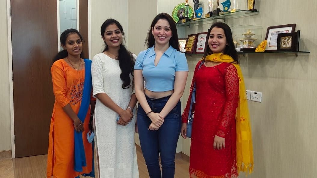 Tamannaah Bhatia with doctors and nurses at a Hyderabad hospital.