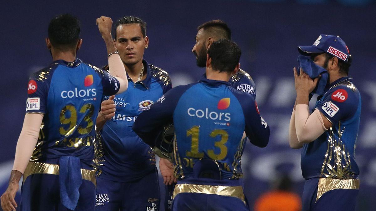 Rahul Chahar of Mumbai Indians celebrates the wicket of Dinesh Karthik, captain of Kolkata Knight Riders, during match 5 of season 13 of Indian Premier League.