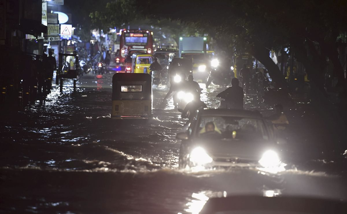Vehicles ply on a waterlogged road during heavy rain triggered by Cyclone Nivar, in Chennai, Tuesday, November 24.