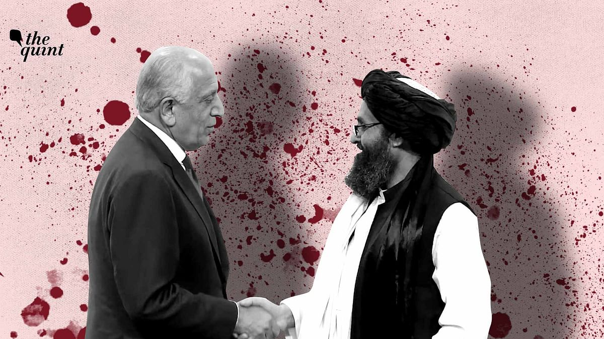 Peace in Afghanistan: US peace envoy Zalmay Khalilzad, left, and Mullah Abdul Ghani Baradar, the Taliban group's top political leader shake hands.