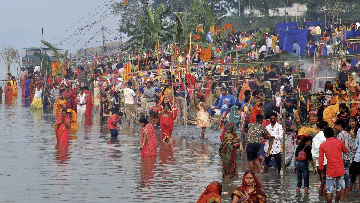 Devotees perform rituals during Chhat Puja at the bank of River Brahmaputra in Guwahati.