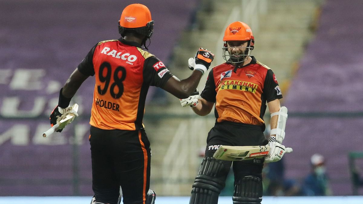 Jason Holder and Kane Williamson celebrate after taking SRH over the line for a six-wicket win against RCB in the Eliminator.