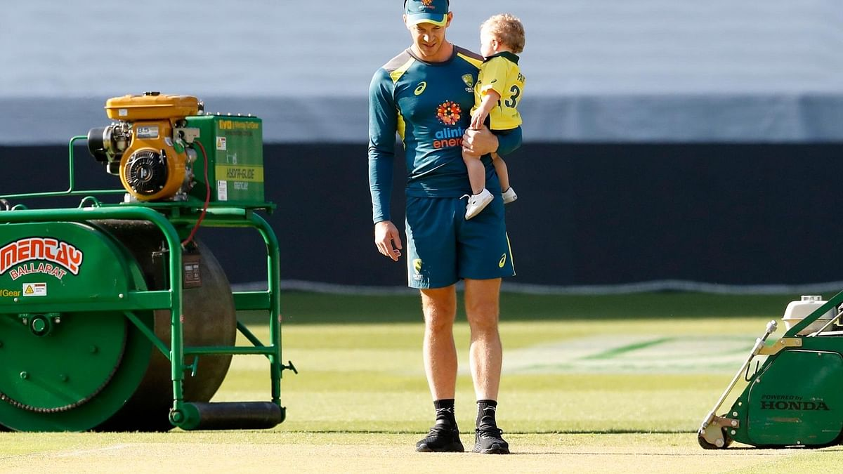 Tim Paine studies the pitch before a Test match at the MCG.