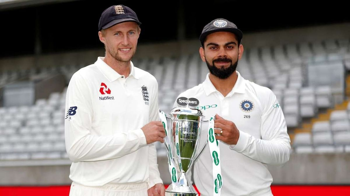 Virat Kohli and Joe Root pose with the trophy.