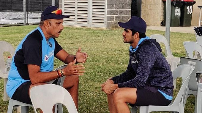 Ravi Shastri and Shubman Gill in conversation during a training session.