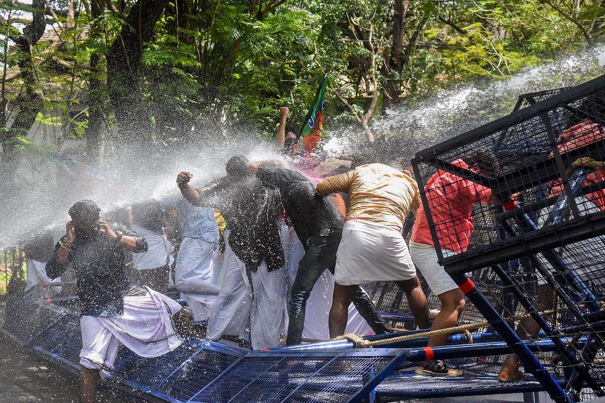 Police uses water cannons to disperse Yuva Morcha activist protesting against Kerala Chief Minister Pinarayi Vijayan, in Kochi.