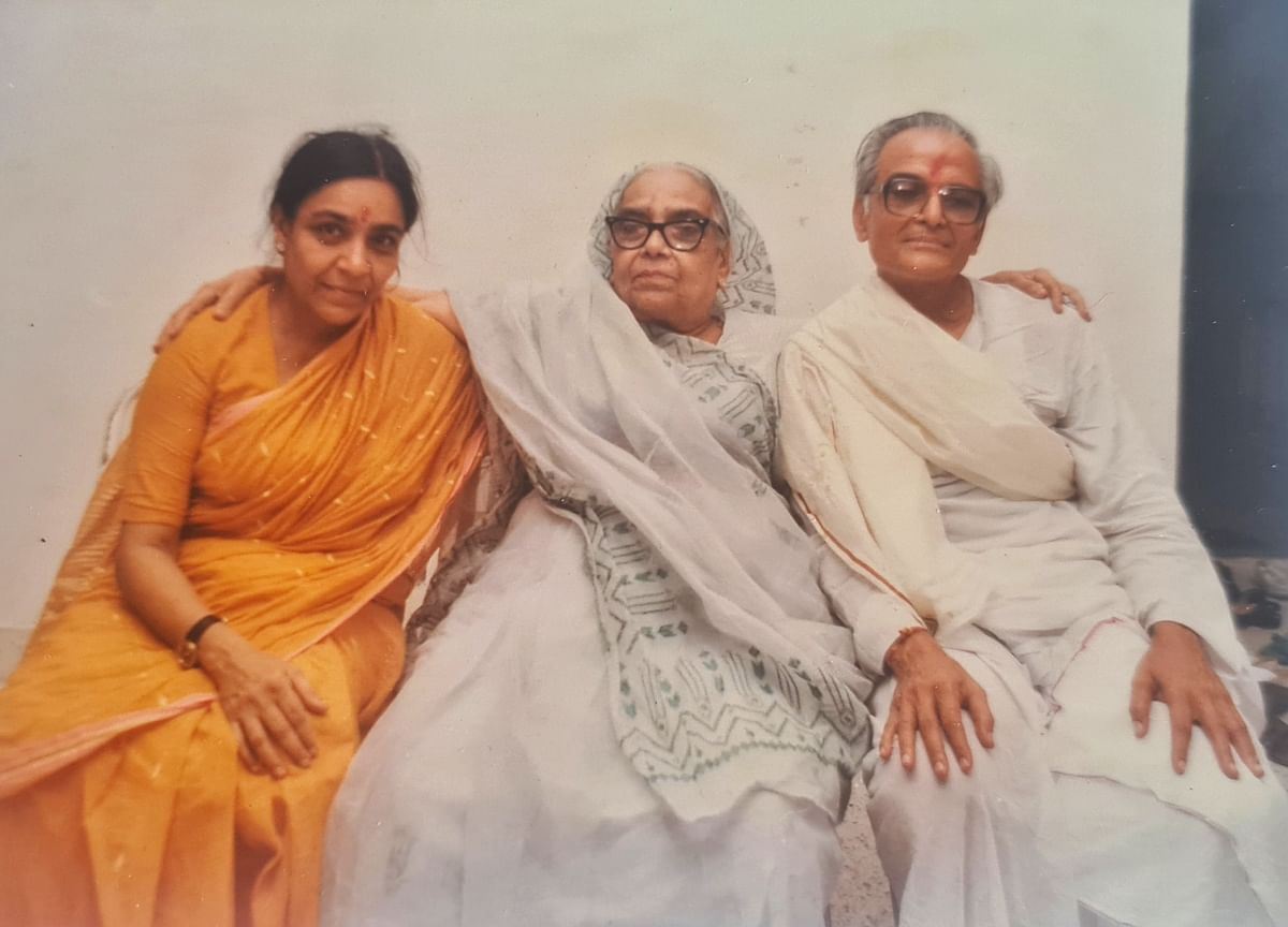 Author's grandmother (centre), wearing a hand-embroidered saree, poses with author's parents