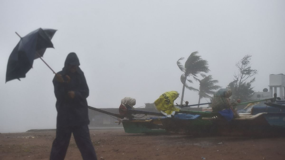 Fishermen move their boats to a safer place near Mamallapuram before the landfall of Cyclone Nivar.