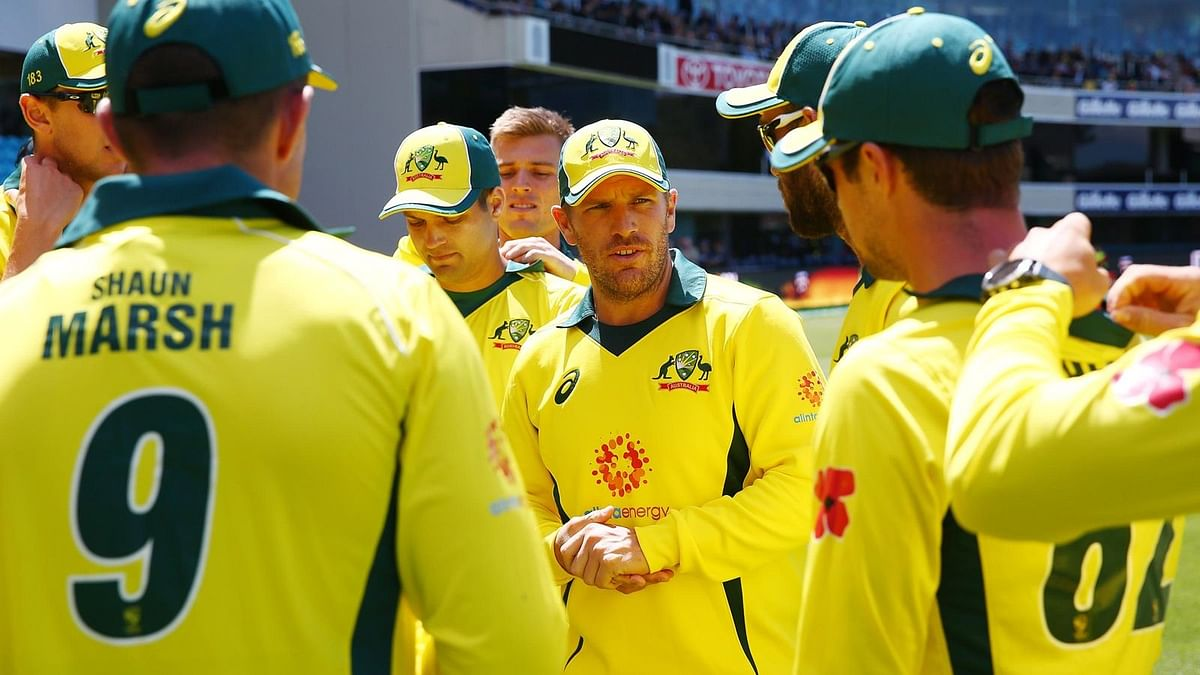 Australian captain Aaron Finch speaks to his team in a huddle.