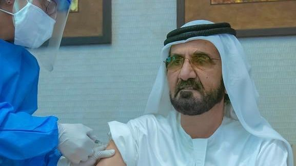 Sheikh Mohammed shared a picture on Twitter of him getting vaccinated by a medical staffer.
