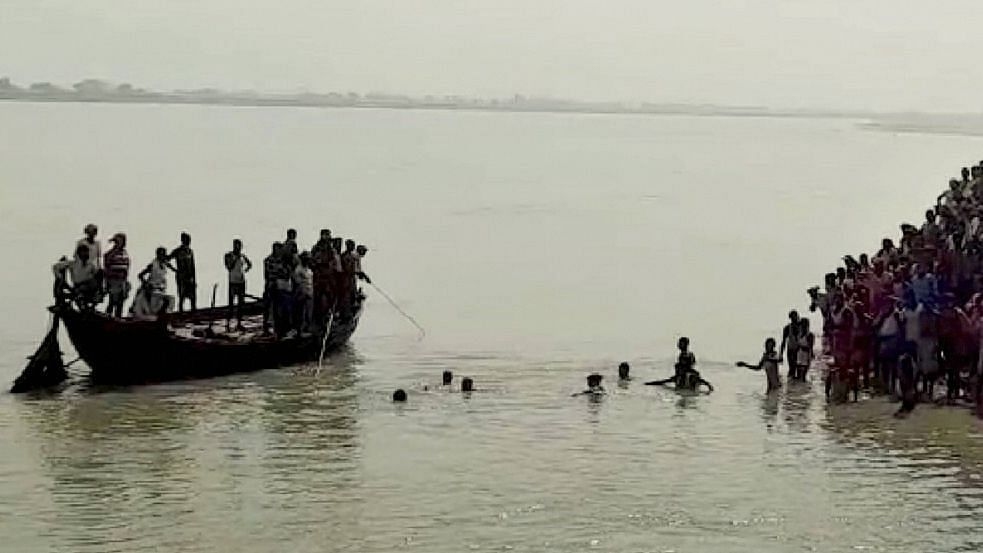 A boat with over 50 passengers overturned in the Ganga near Bihar's Bhagalpur district
