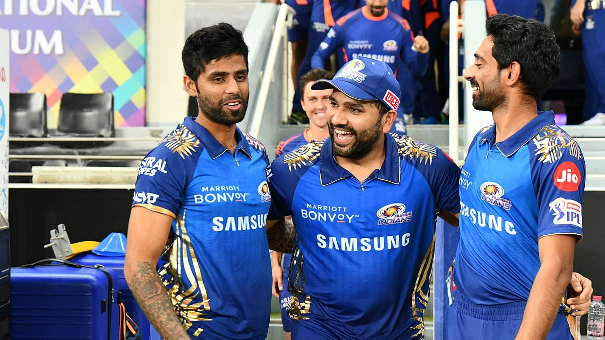 Suryakumar Yadav and Rohit Sharma celebrate with the Mumbai Indians team.