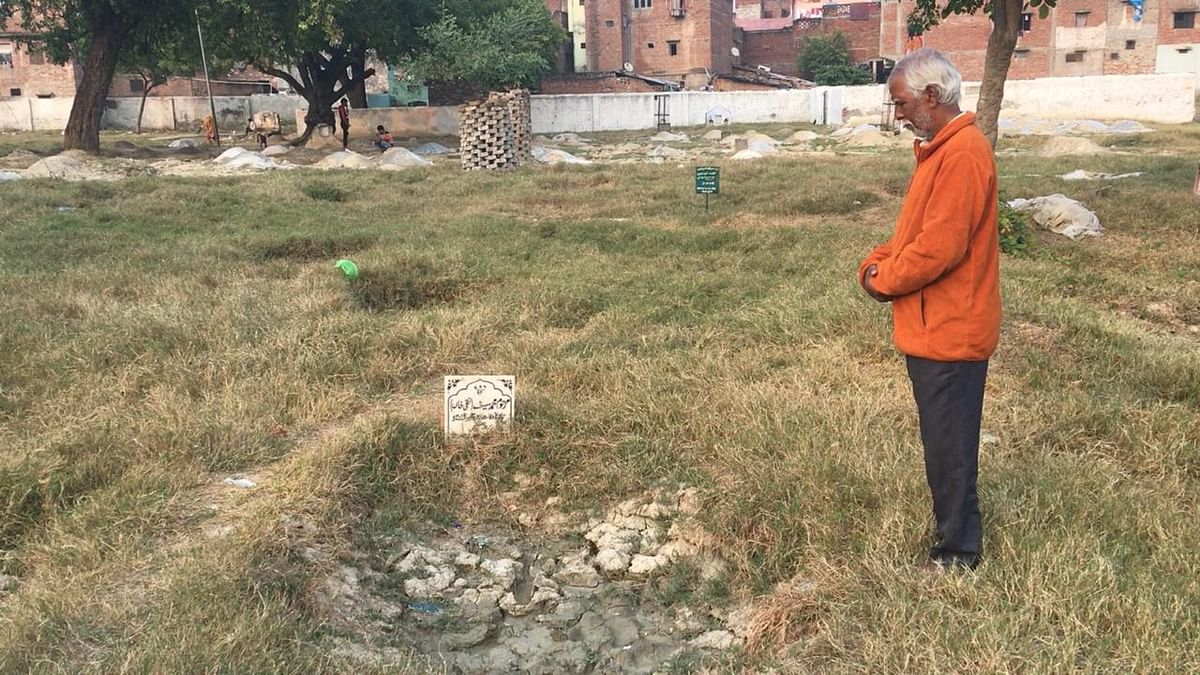62-year-old Mohammad Taqi at his son's grave in Kanpur.