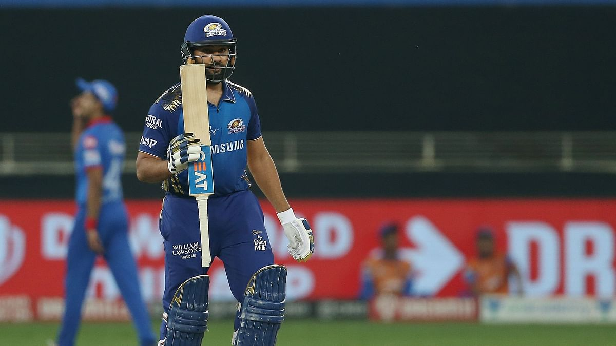Rohit Sharma acknowledges the cheers for his half century.