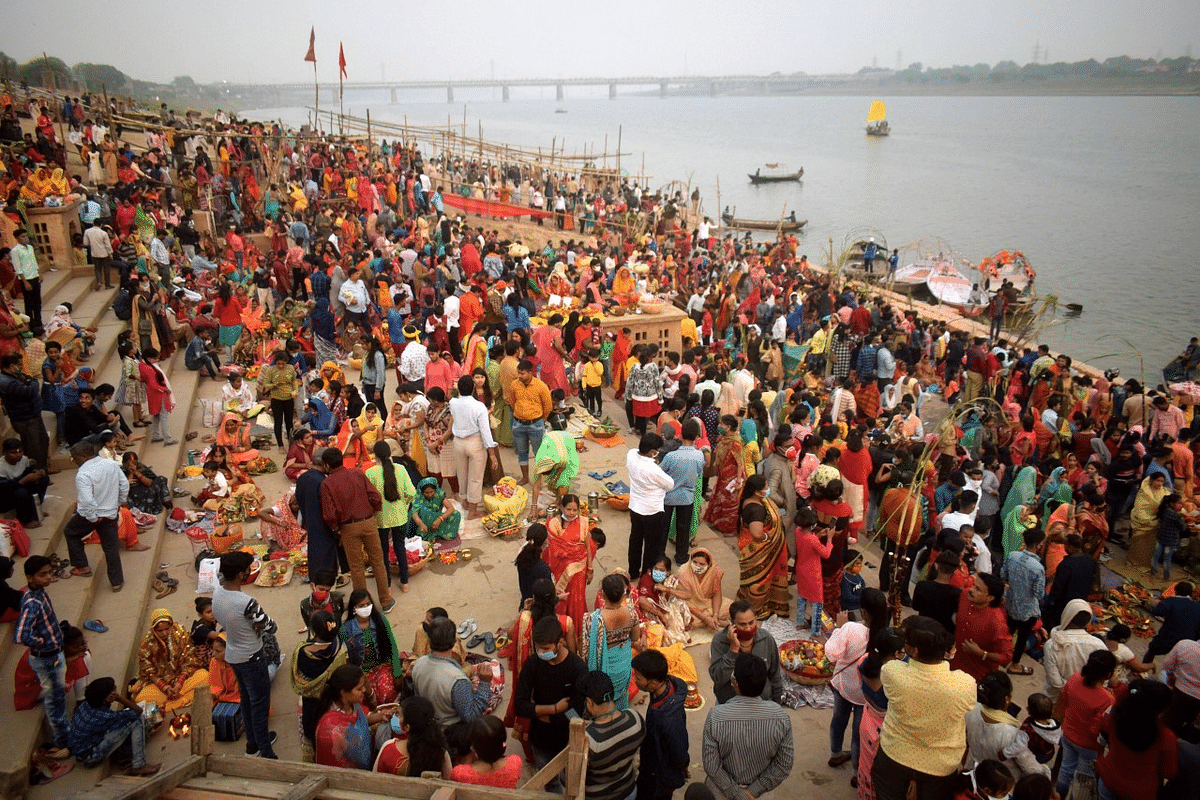 Devotees offer prayers on the banks of Yamuna river on the occasion of Chhath Puja festival in Prayagraj.