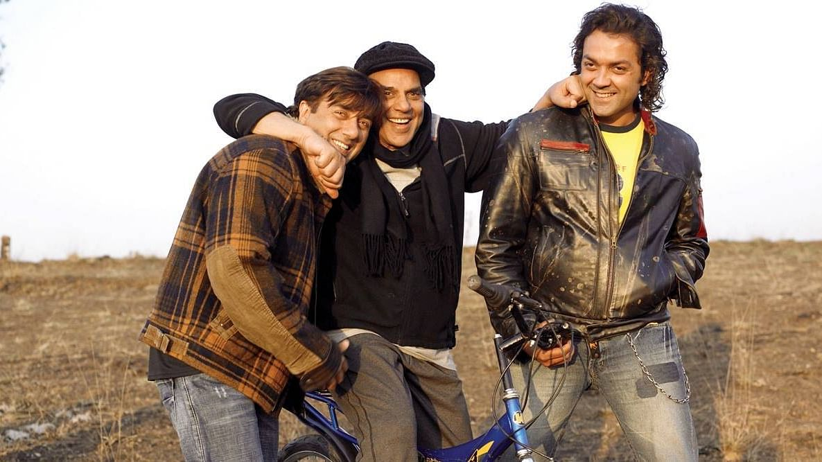 Dharmendra, Bobby and Sunny Deol in Apne.