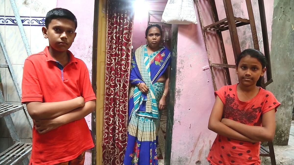 Pranay, Yogita and Pranali outside their home in Dharavi.